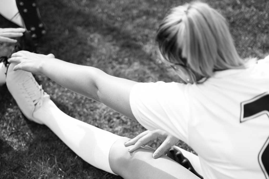 Athlete performing hamstring stretch