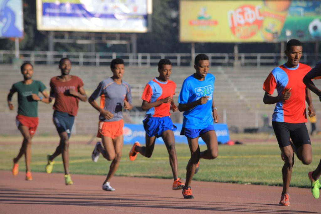 Track runners with good heel lift and arm movement
